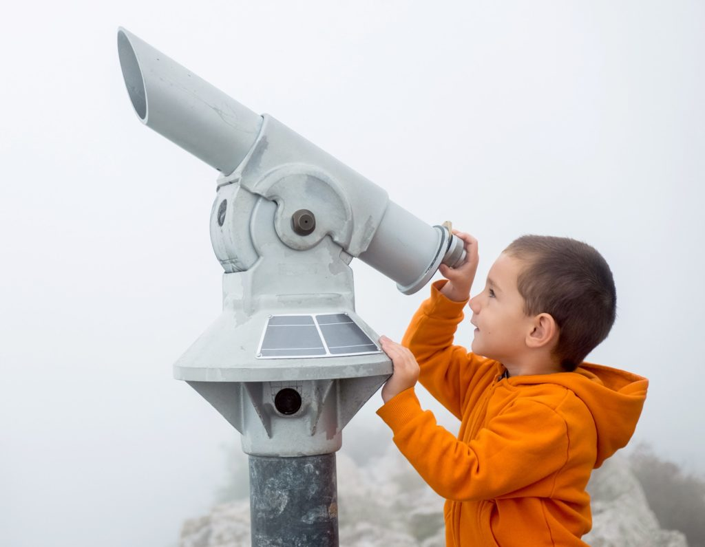 Boy looking into the sky
